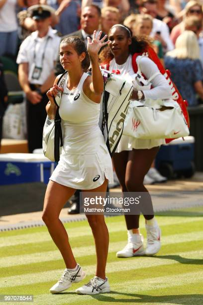 Julia Goerges of Germany and Serena Williams of The United States leave the court after their Ladies' Singles semifinal match on day ten of the...