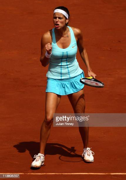 Julia Goerges of Germany celebrates winning a game in her match against Anastasia Pavlyuchenkova of Russia during day seven of the Mutua Madrilena...