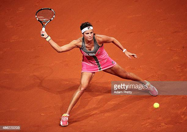 Julia Goerges of Germany hits a forehand during her match against Sorana Cirstea of Romania during day 3 of the Porsche Tennis Grand Prix 2014 at...