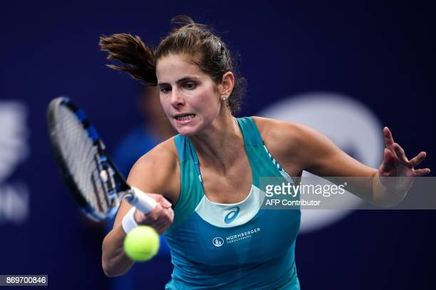 Julia Goerges of Germany hits a return against Kristina Mladenovic of France during their women's singles match at the Zhuhai Elite Trophy tennis...