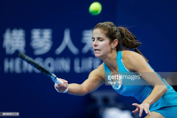 Julia Goerges of Germany hits a return in her match against Kristina Mladenovic of France during the WTA Elite Trophy Zhuhai 2017 at Hengqin Tennis...