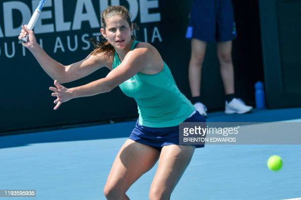 Julia Goerges of Germany hits a return to Priscilla Hon of Australia during their women's first round singles match at the Adelaide International...