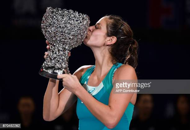 Julia Goerges of Germany kisses the trophy after her victory against Coco Vandeweghe of the US in the women's singles final at the Zhuhai Elite...