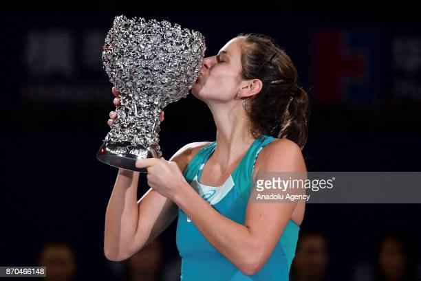 Julia Goerges of Germany kisses the trophy after winning against CoCo Vandeweghe of United States in the women's singles final match of the 2017 WTA...