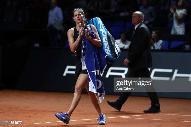 Julia Goerges of Germany leaves the court after retiring from her first round match against Anastasia Pavlyuchenkova of Russia on day 3 of the...