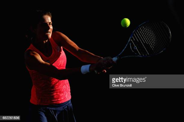Julia Goerges of Germany plays a backhand against Samantha Stosur of Australia in their second round match during day six of the BNP Paribas Open at...