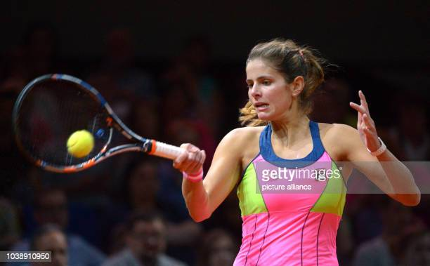 Julia Goerges of Germany plays a forehand during her match against Bencic of Switzerland in the first round of the WTATennisTournament in Stuttgart...