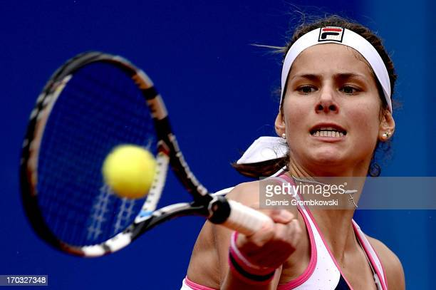 Julia Goerges of Germany plays a forehand her first round match against Alexandra Cadantu of Romania during day four of the Nuernberger Insurance Cup...