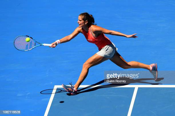 Julia Goerges of Germany plays a forehand in her first round match against Danielle Collins of the United States during day one of the 2019...