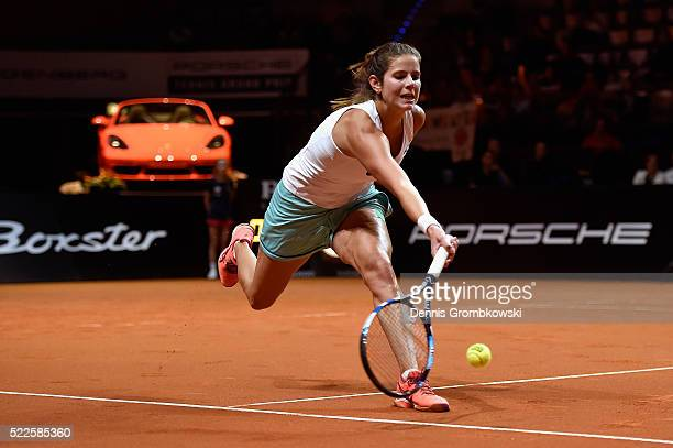 Julia Goerges of Germany plays a forehand in her match against Alize Cornet of France during Day 3 of the Porsche Tennis Grand Prix at PorscheArena...