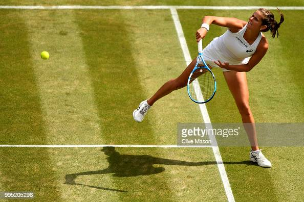 Julia Goerges of Germany plays a forehand smash against Kiki Bertens of the Netherlands during their Ladies' Singles QuarterFinals match on day eight...