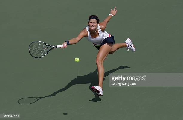 Julia Goerges of Germany plays a shot against Silvia SolerEspinosa of Spain during day one of the KDB Korea Open at Olympic Park Tennis Stadium on...