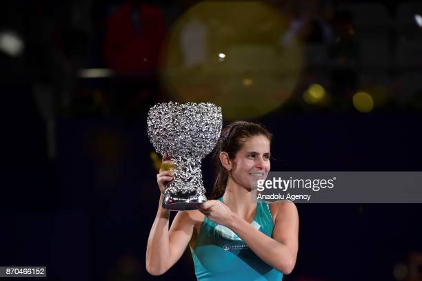 Julia Goerges of Germany poses with the trophy after winning against CoCo Vandeweghe of United States in the women's singles final match of the 2017...