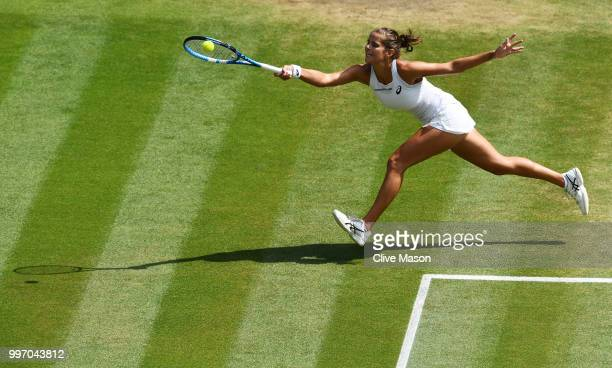 Julia Goerges of Germany returns against Serena Williams of The United States during their Ladies' Singles semifinal match on day ten of the...