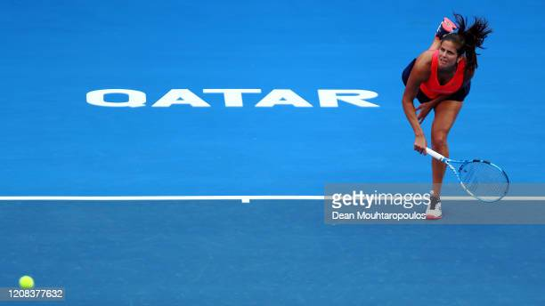 Julia Goerges of Germany serves against Maria Sakkari of Greece during Day 2 of the WTA Qatar Total Open 2020 at Khalifa International Tennis and...
