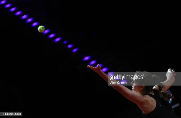 Julia Goerges of Germany serves the ball to Anastasia Pavlyuchenkova of Russia during their first round match on day 3 of the Porsche Tennis Grand...