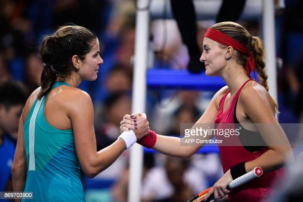 Julia Goerges of Germany shakes hands with Kristina Mladenovic of France during their women's singles match at the Zhuhai Elite Trophy tennis...