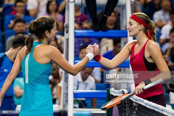 Julia Goerges of Germany shakes hands with Kristina Mladenovic of France after winning the singles Round Robin match of the WTA Elite Trophy Zhuhai...
