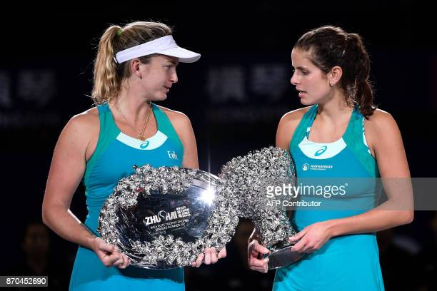 Julia Goerges of Germany speaks with Coco Vandeweghe of the US on the podium after her victory in the women's singles final at the Zhuhai Elite...