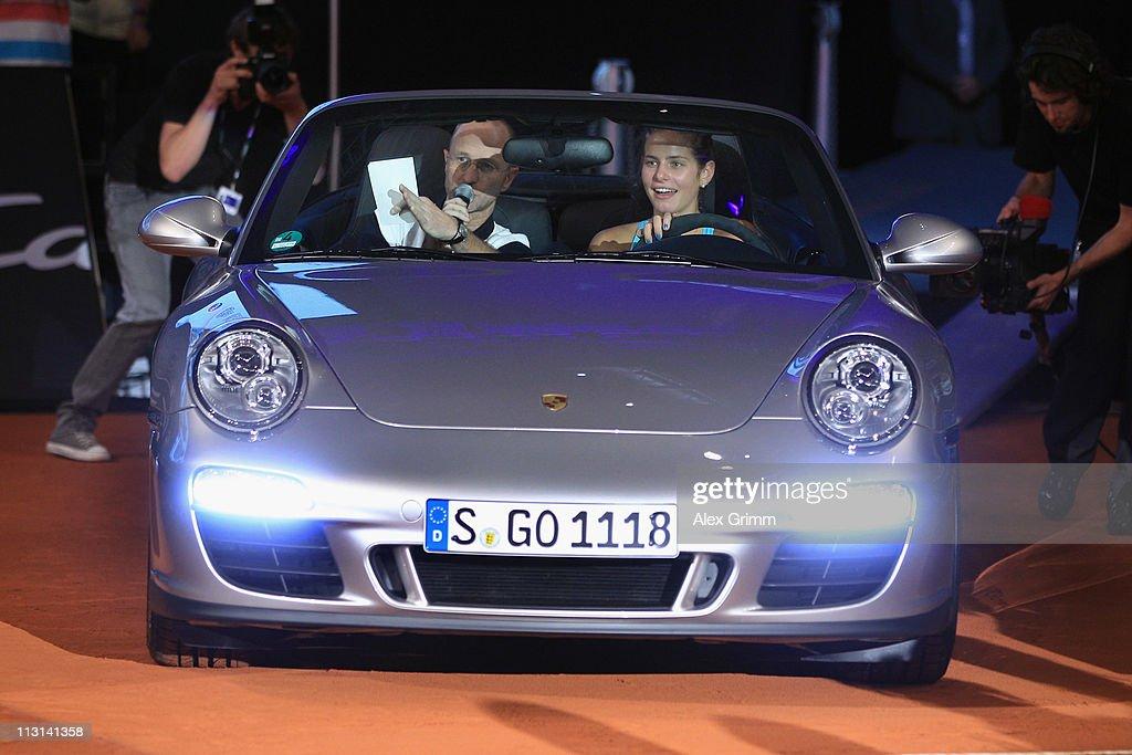Julia Goerges of Germany steers her new Porsche Carrera 911