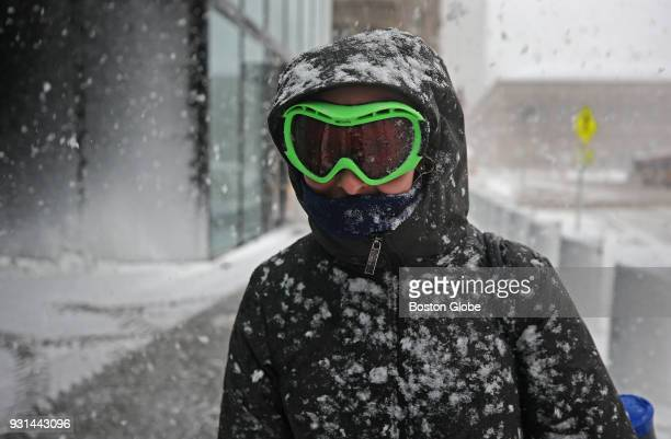Julia Gorman of Boston uses her ski goggles to see through the snow along St James Avenue in Boston during the third nor'easter storm to hit the...