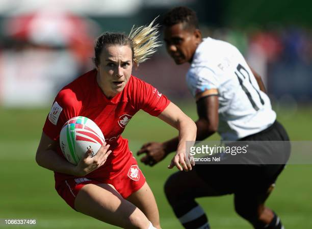 Julia Greenshield of Canada runs with the ball on day one of the Emirates Dubai Rugby Sevens HSBC World Rugby Sevens Series at The Sevens Stadium on...