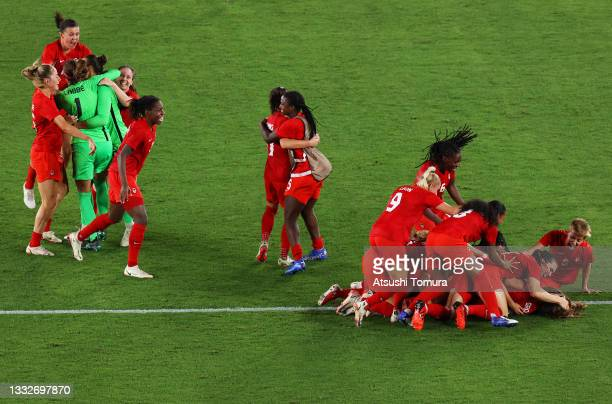 Julia Grosso of Team Canada celebrates with team mates after scoring their sides winning penalty in the penalty shoot out in the Women's Gold Medal...