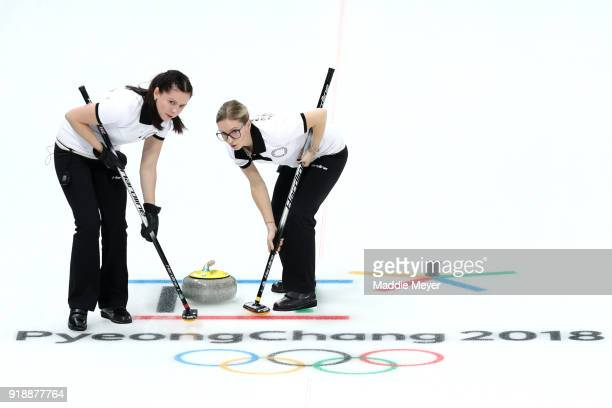 Julia Guzieva and Galina Arsenkina of Olympic Athlete from Russia sweep during their game against Sweden Curling Women's Round Robin Session 4 at...