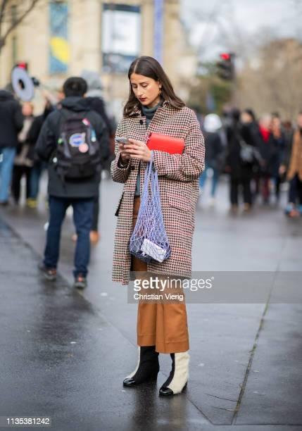 Julia Haghjoo is seen wearing net bag plaid jacket outside Miu Miu during Paris Fashion Week Womenswear Fall/Winter 2019/2020 on March 05 2019 in...