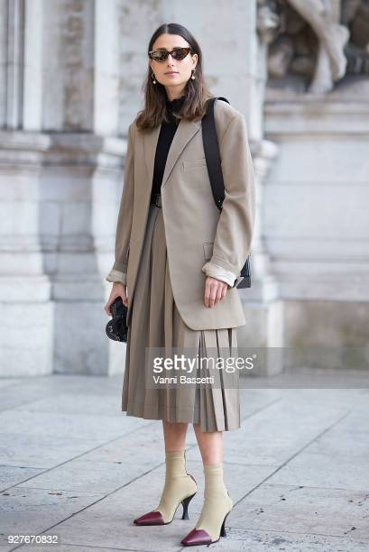 Julia Haghjoo poses wearing Celine jacket and skirt and a Dior bag before the Stella McCartney show at the Opera Garnier during Paris Fashion Week...