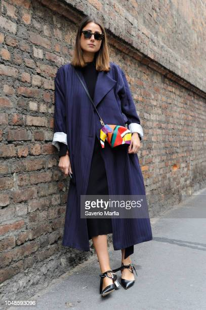 Julia Haghjoo poses with a Loewe bag before the Max Mara show during Milan Fashion Week Fall/Winter 2017/18 on February 23 2017 in Milan Italy