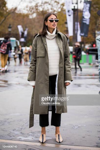Julia Haghjoo wearing a beige sweater black pants army green trench coat and beige heels is seen before the Chanel show on October 2 2018 in Paris...