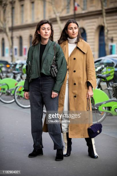 Julia Haghjoo wearing a black top black denim jeans black shoes and green jacket and Sylvia Haghjoo wearing cream jumper cream pants black and cream...