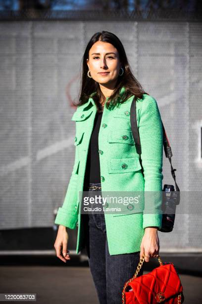 Julia Haghjoo, wearing a green jacket, black jeans and red Chanel bag, is seen outside Chanel, during Paris Fashion Week - Haute Couture...