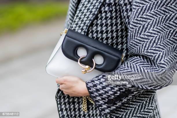 Julia Haghjoo wearing a grey Burberry coat Zara pants Proenza Shouler shoes JW Anderson bag Celine braclet Balenciaga earrings Le Specs sunglasses on...