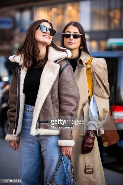Julia Haghjoo wearing a long beige trench coat burgundy gloves and brown bag and Sylvia Haghjoo wearing black top grey jacket with fur details and...