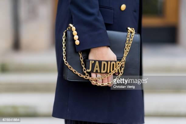 Julia Haghjoo wearing a navy Ralph Lauren blazer cropped striped Zara pants Acne leather shoes flats Dior bag Fendi earrings Celine bracelet...