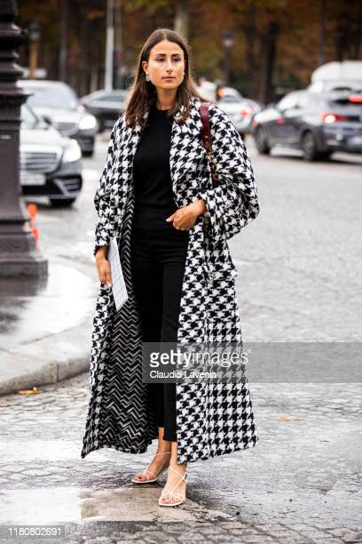 Julia Haghjoo, wearing a Prince of Wales coat and white sandals, is seen outside the Chanel show during Paris Fashion Week - Womenswear Spring Summer...