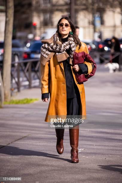 Julia Haghjoo, wearing a tan leather coat, burgundy bag and brown boots, is seen outside Miu Miu, during Paris Fashion Week - Womenswear Fall/Winter...