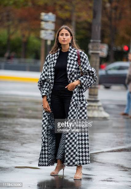 Julia Haghjoo wearing black white checkered coat seen outside Chanel during Paris Fashion Week Womenswear Spring Summer 2020 on October 01, 2019 in...