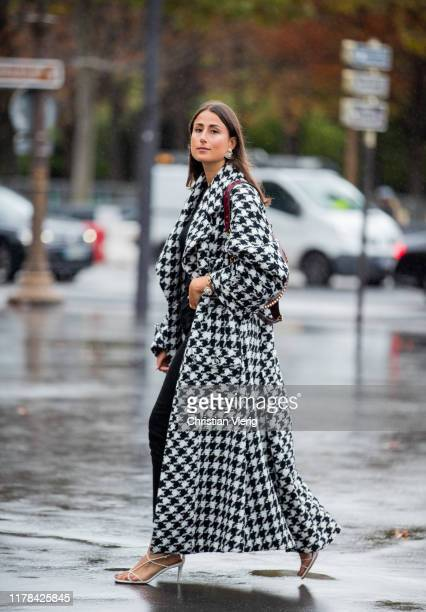 Julia Haghjoo wearing black white checkered coat seen outside Chanel during Paris Fashion Week Womenswear Spring Summer 2020 on October 01 2019 in...