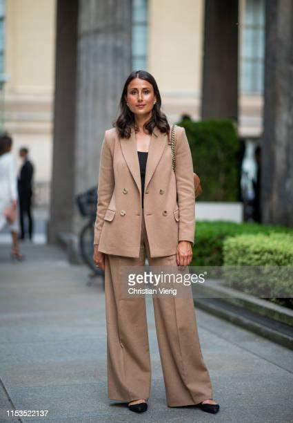 Julia Haghjoo wearing brown suit outside Max Mara Resort 2020 on June 03, 2019 in Berlin, Germany.