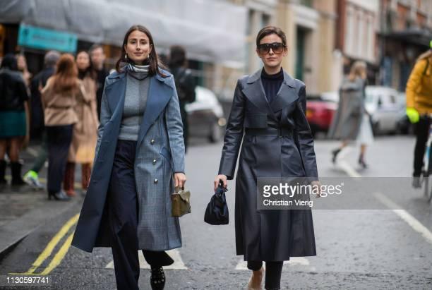 Julia Haghjoo wearing coat and Sylvia Haghjoo is seen wearing navy coat outside REJINA PYO during London Fashion Week February 2019 on February 18,...