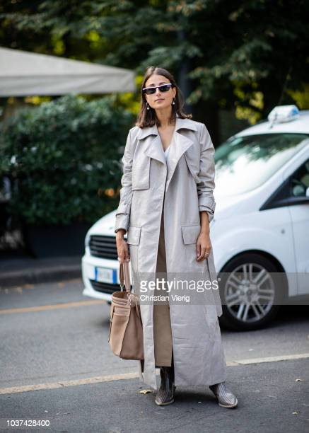 Julia Haghjoo wearing grey trench coat seen outside Tods during Milan Fashion Week Spring/Summer 2019 on September 21, 2018 in Milan, Italy.
