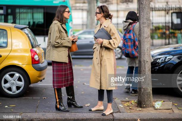 Julia Haghjoo wearing oliver jacket red plaid skirt boots orange bucket bag and Sylvia Haghjoo wearing two tone trench coat Loewe bag Chanel shoes...