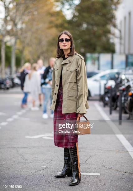 Julia Haghjoo wearing oliver jacket red plaid skirt boots orange bucket bag is seen outside Sacai during Paris Fashion Week Womenswear Spring/Summer...