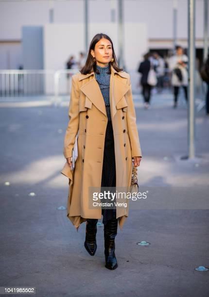 Julia Haghjoo wearing trench coat Chloe bag black boots is seen outside Chloe during Paris Fashion Week Womenswear Spring/Summer 2019 on September 27...