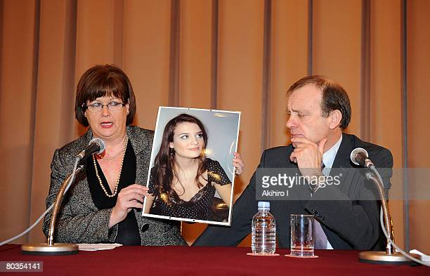 Julia Hawker holds a portrait of her murdered daughter Lindsay Ann Hawker besides her husband Bill, during a press conference at Japan National Press...