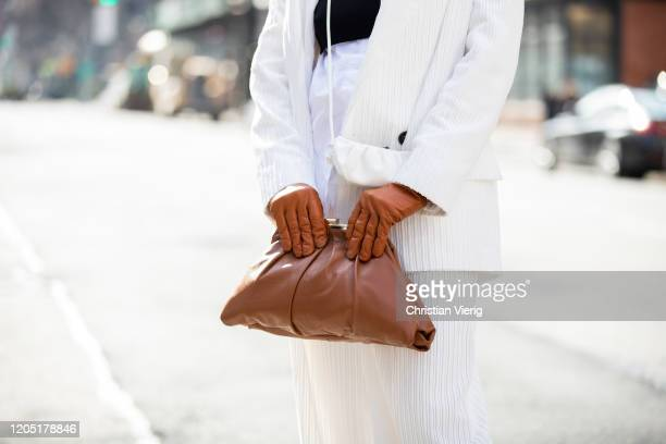 Julia Hayek is seen wearing white blazer pants Asos brown bag and gloves Zara during New York Fashion Week Fall / Winter on February 09 2020 in New...