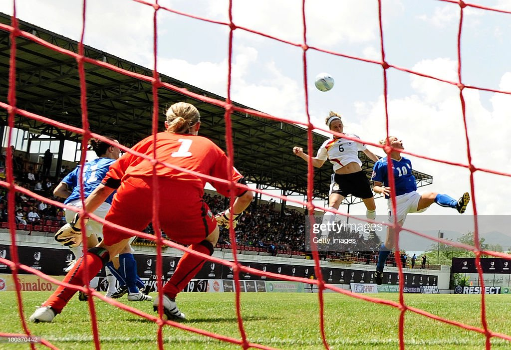 Julia Hendrich (C) of Germany heads for the ball with Martina Rossouci of Italy during the UEFA Women's Under-19 European Championship group A match between Germany and Italy at Milano Arena on May 24, 2010 in Kumanovo, Macedonia.